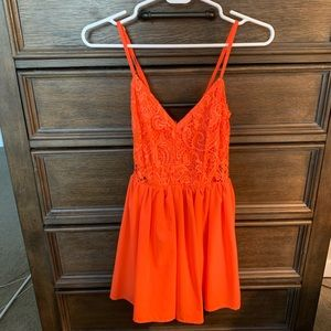 Tobi bright orange romper size small, lace